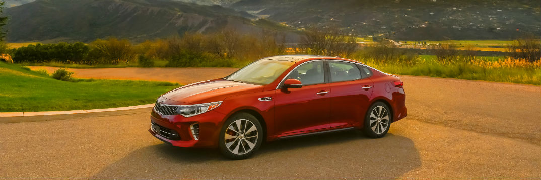 2018 Kia Optima parked in a verdant and hilly area