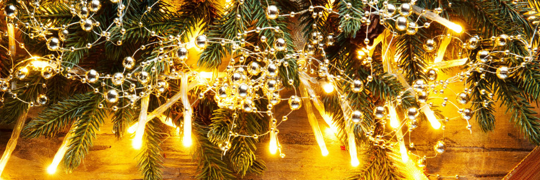 Holiday-themed background image with lights and a wreath