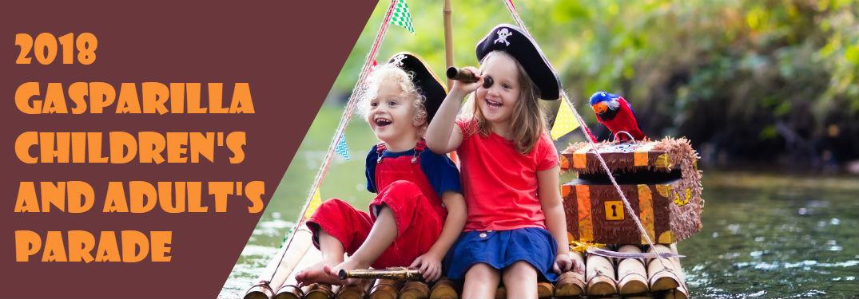 children on small raft with papier mache pirates treasure chest