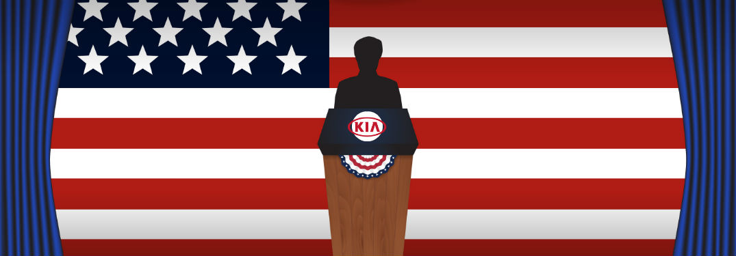 presidential podium in front of American flag with Kia logo on podium