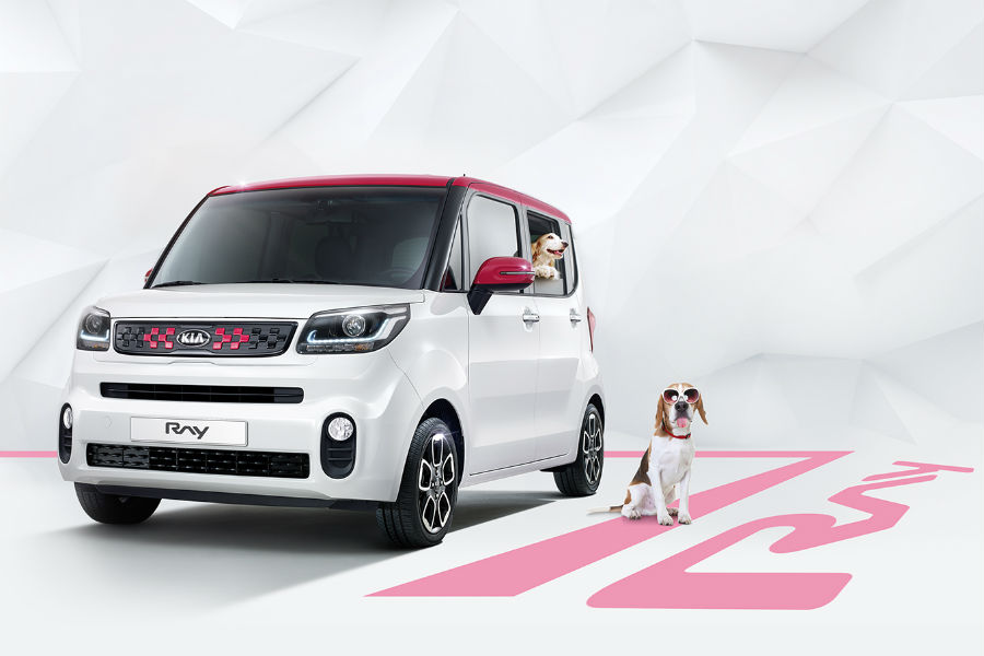 facelifted kia ray in white against white background with dog sitting nearby