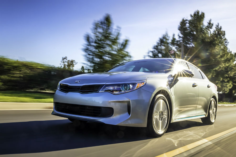 2018 kia optima phev driving on road up close detail of front three quarter