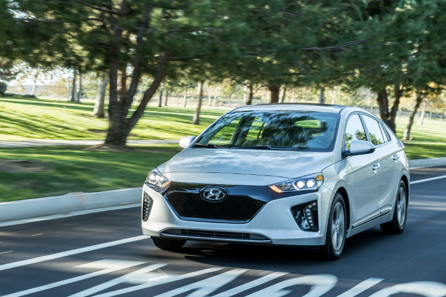 2018 Hyundai Ioniq hybrid driving down street in white color