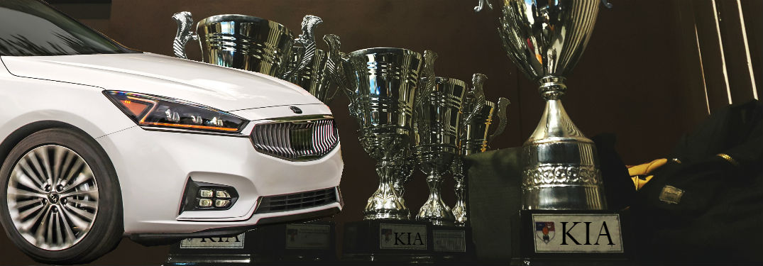 2018 kia cadenza in white overlaid on trophies