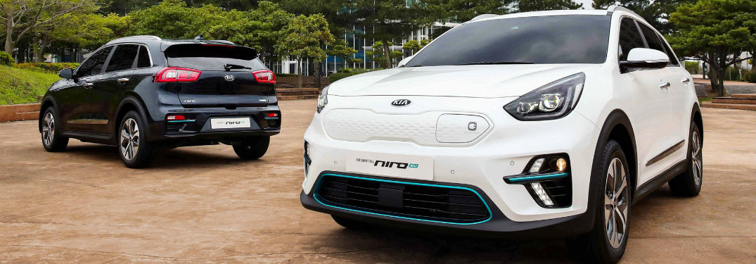 front view of white Kia Niro EV with Kia Niro behind it facing the other direction
