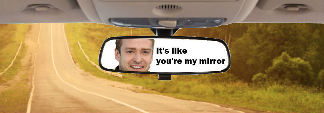 interior of car driving on the road with justin timberlake in rearview mirror and lyrics to his song mirrors