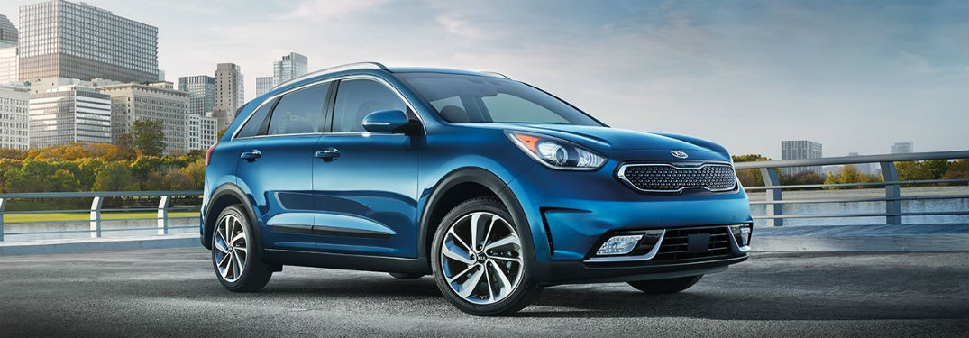 2018 Kia niro in dark blue driving on road