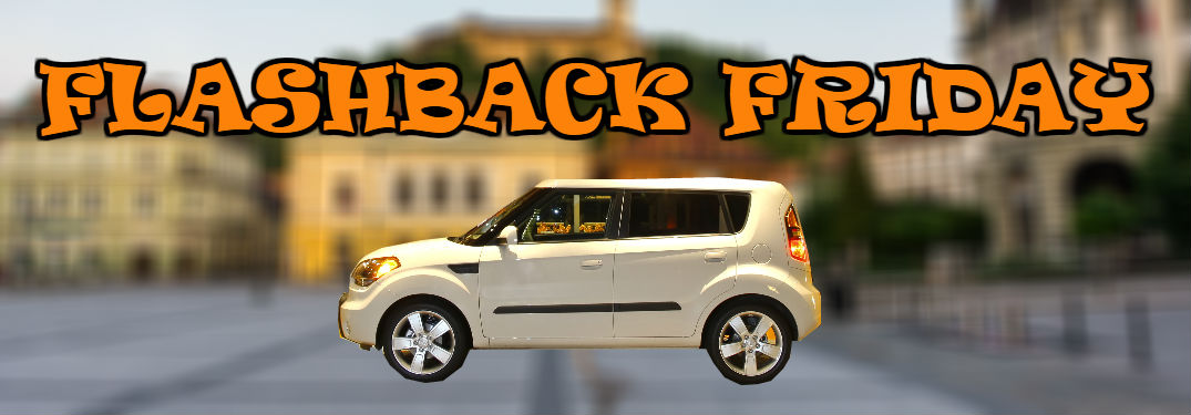 first-generation kia soul in front of blurry city background with Flashback Friday text superimposed