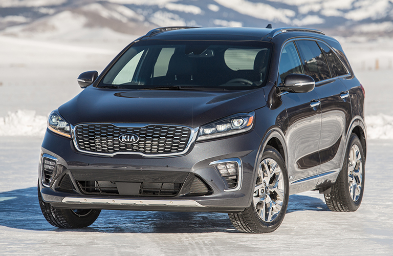 blue 2019 kia sorento parked on snow