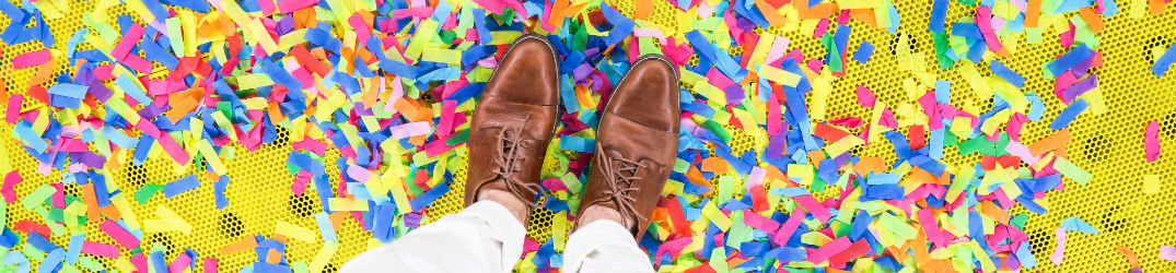 feet standing on a pile of confetti