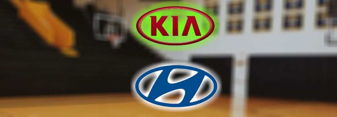 kia logo and hyundai logo against blurry basketball hoop backdrop