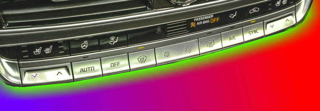kia automatic climate control unit in front of red to blue gradient