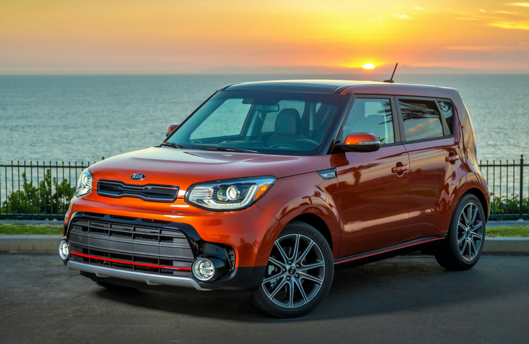 red 2019 kia soul in front of sunset