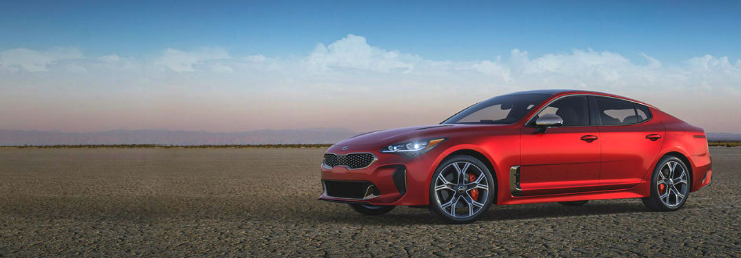 red kia stinger on blue sky background