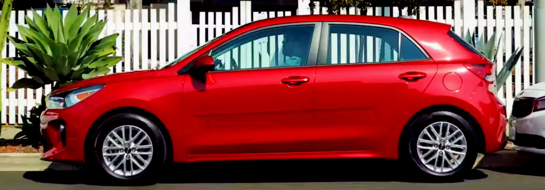 profile of red kia rio 5 door