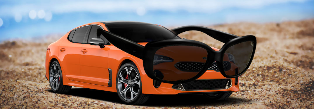 2019 kia stinger in orange with sunglasses on