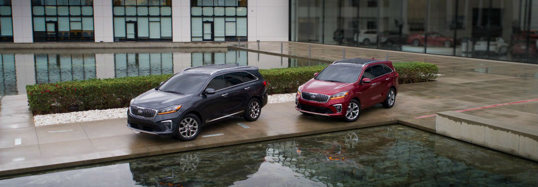 pair of 2020 kia sorento SUVs in front of a nice big pool