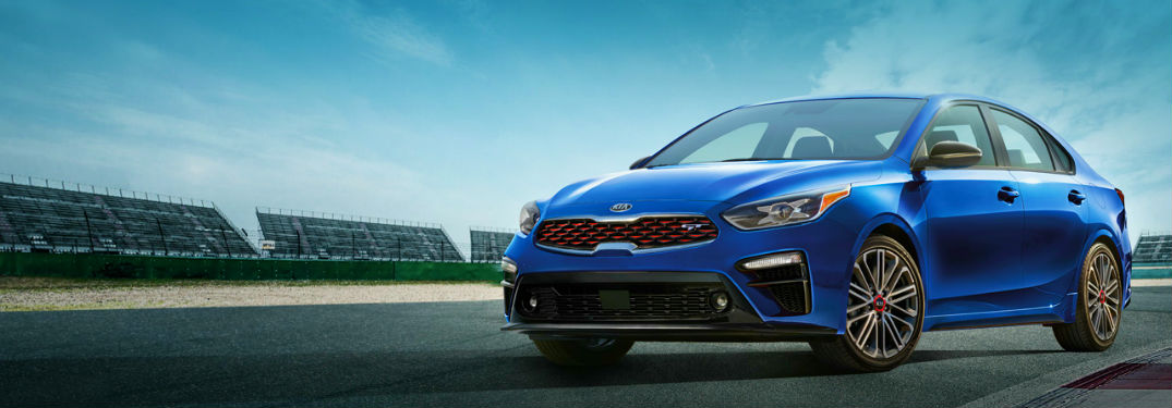 blue 2020 kia forte gt on track