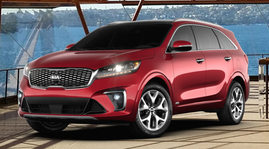 2020 Kia Sorento against operatic background in passion red