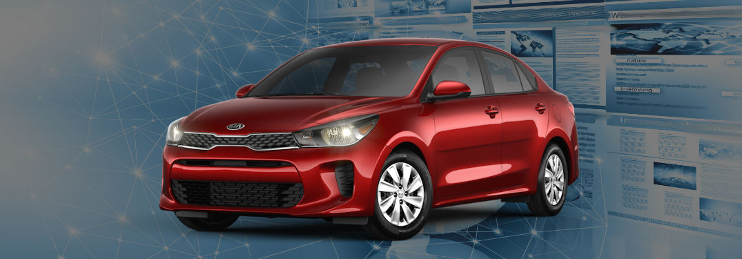red 2020 kia rio parked in front of generic technology background