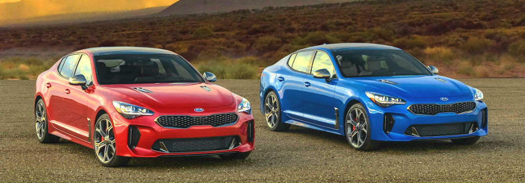 2020 kia stinger in red and blue side by side