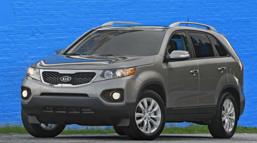 exterior of 2011 kia sorento on blue background