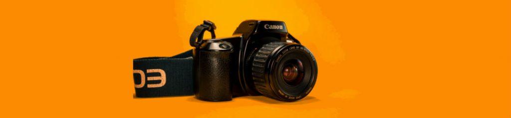 canon dslr on orange background