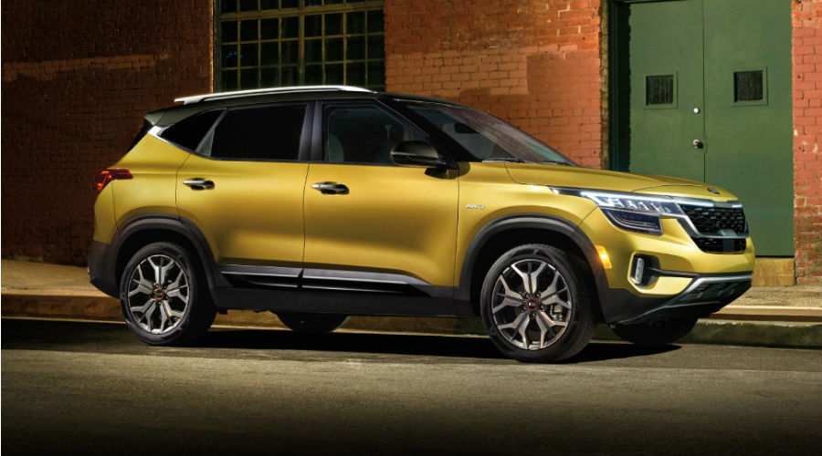 side profile of the 2021 kia seltos in yellow