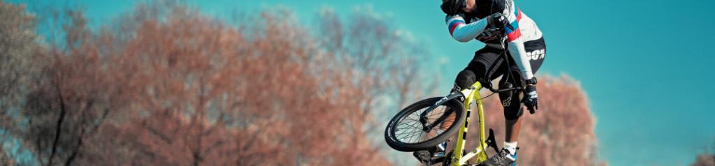 Closeup of BMX rider in air