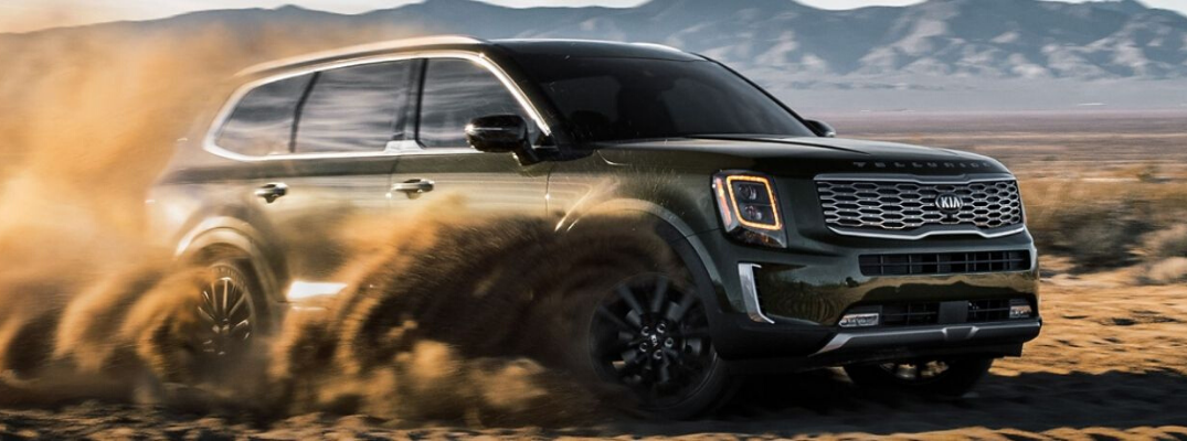 Green 2020 Kia Telluride driving through dirt