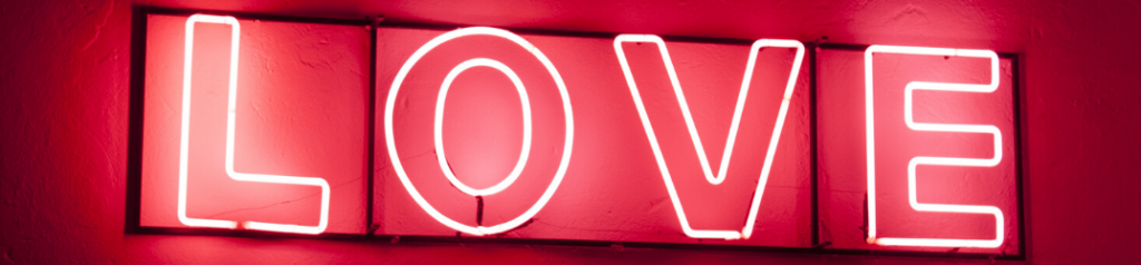 "Red ""LOVE"" neon sign"