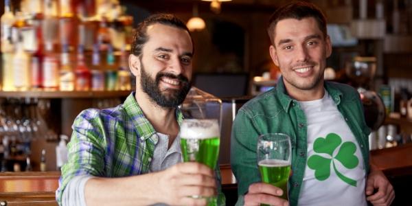 Men holding green beers