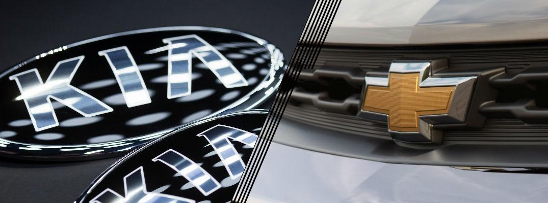 Closeup of Kia and Chevrolet logos