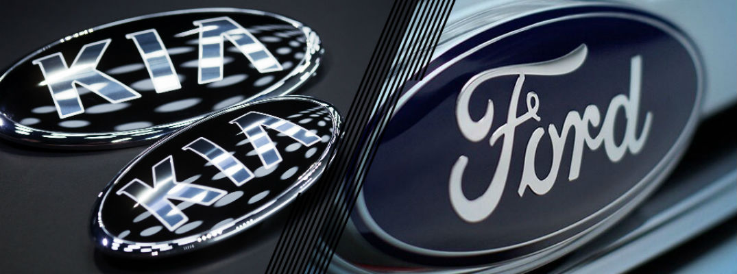 Closeup of Kia and Ford emblems