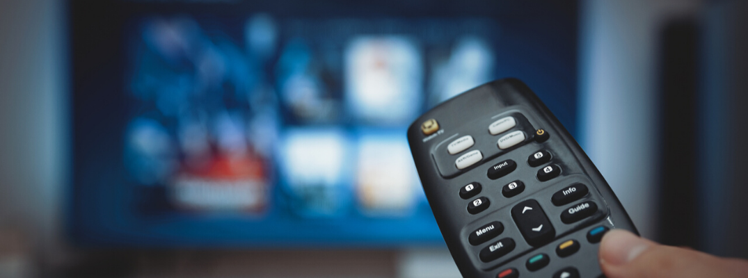 Closeup of remote pointing at TV