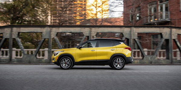 Side view of yellow 2021 Kia Seltos