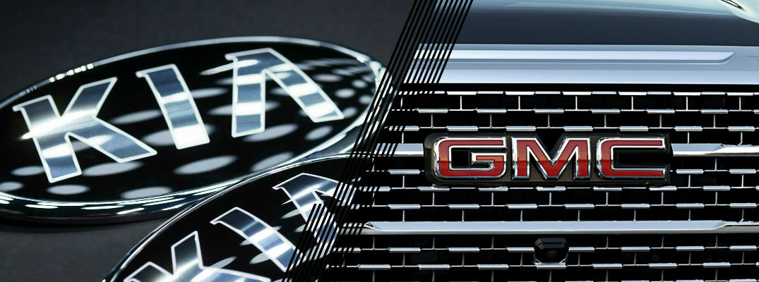Closeup of Kia logo and GMC logo
