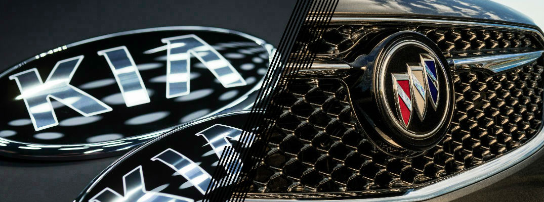Closeup of Kia logo and Buick logo