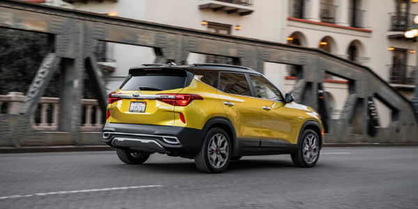Rear exterior view of yellow 2021 Kia Seltos