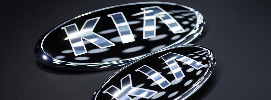 Closeup of two Kia logos