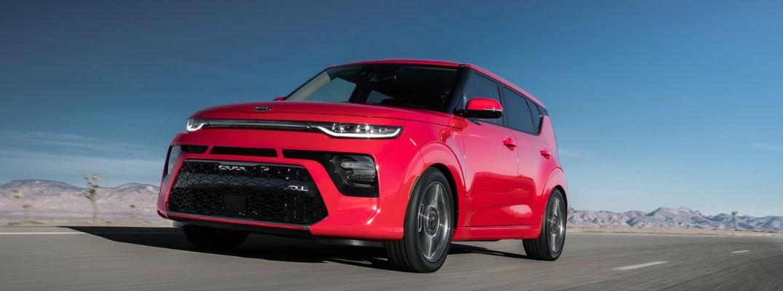 Red 2021 Kia Soul driving