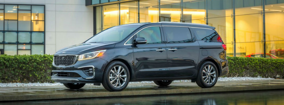 Side view of black 2021 Kia Sedona