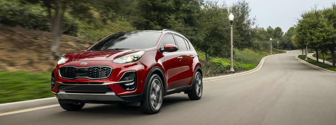 Red 2021 Kia Sportage driving