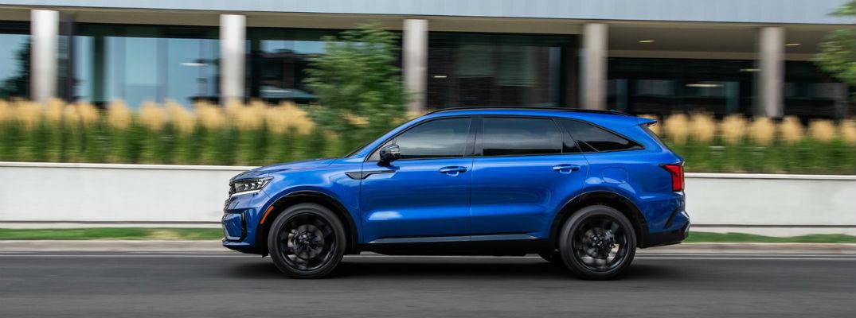 Profile view of blue 2021 Kia Sorento driving
