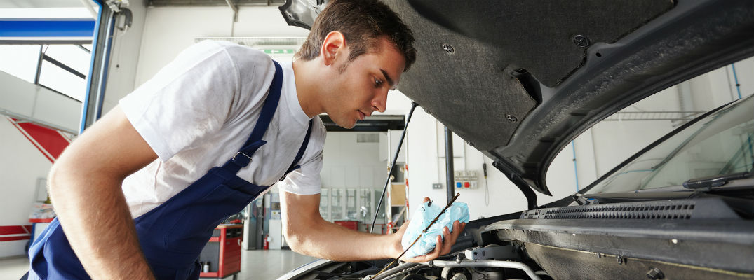 Mechanic working under vehicle hood
