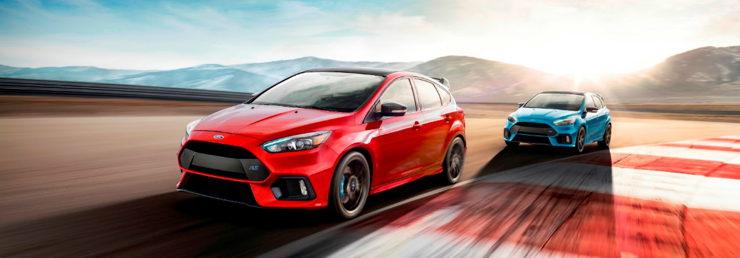 Red and Blue 2018 Ford Focus RS Vehicles Racing on a Track