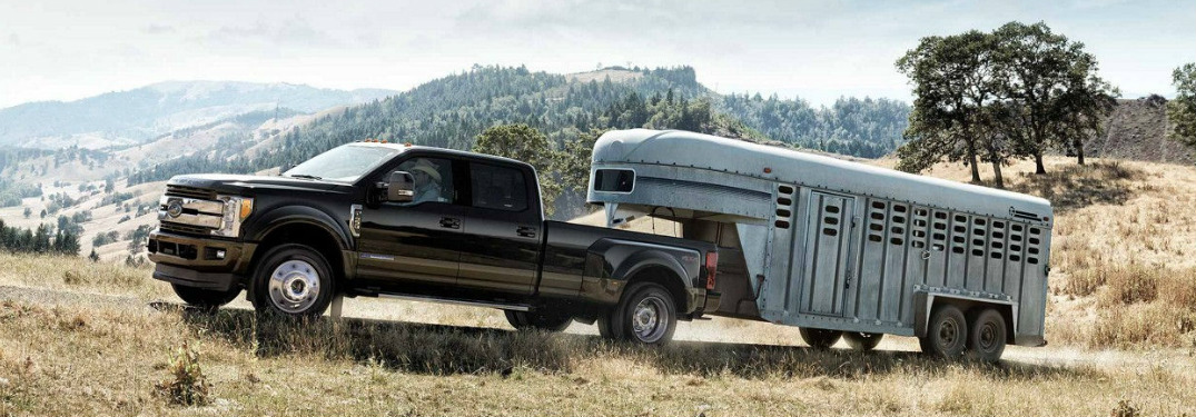 Black 2018 Ford Super Duty Towing a Horse Trailer