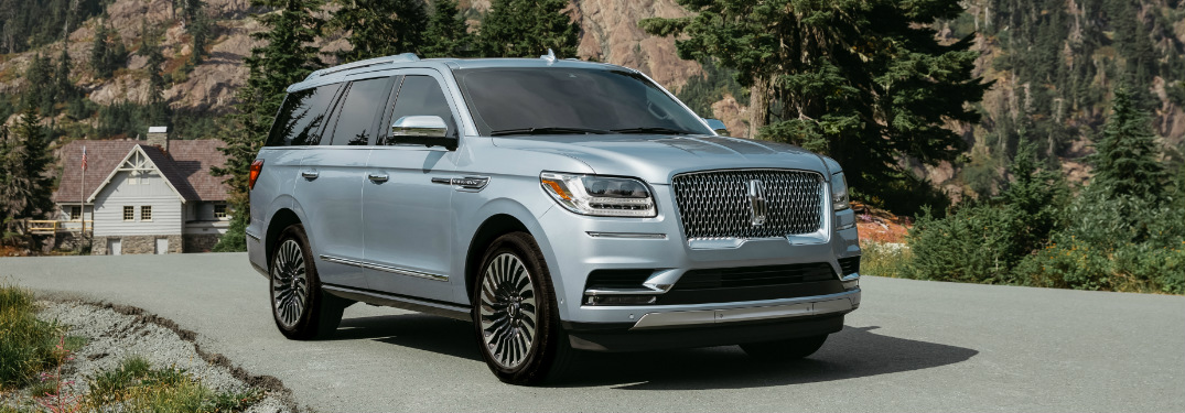 Silver 2018 Lincoln Navigator Parked on a Road near a House