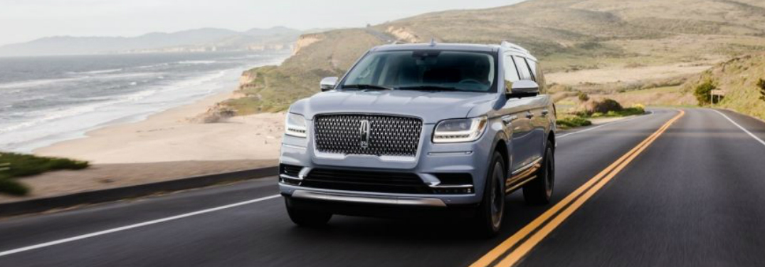 Silver 2018 Lincoln Navigator Driving on a Coastal Road