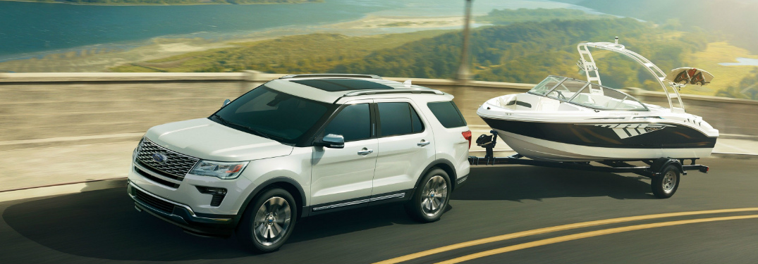 A white 2019 Ford Explorer towing a boat